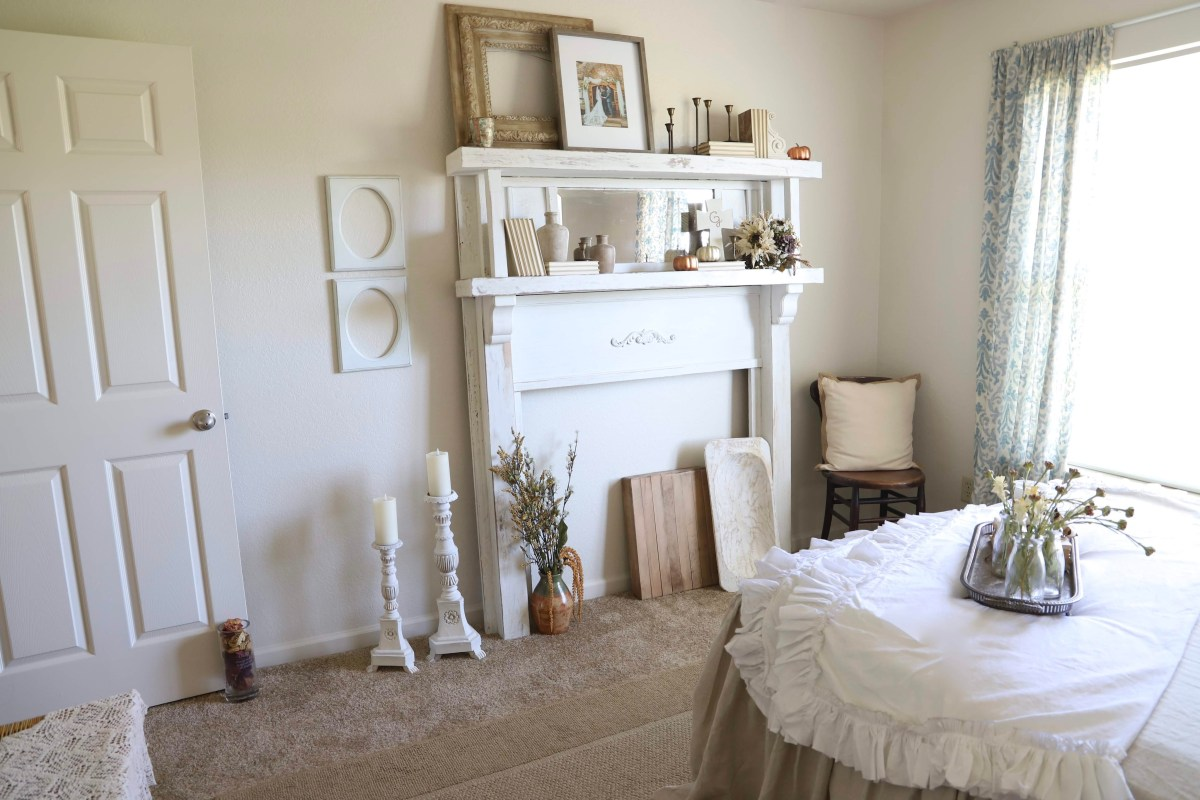 Shabby Chic Bedroom, with a restored antique mantel.