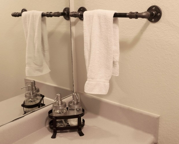 how to make a cookie cutter bathroom feel less generic and more custom