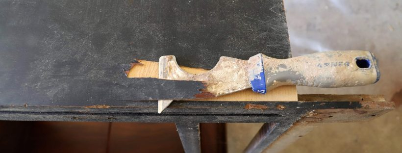 Remove an old wood veneer using a putty knife