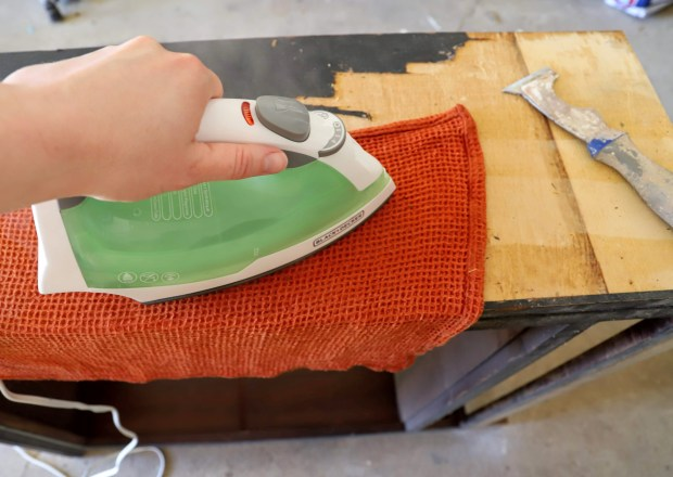 Remove an old wood veneer by loosening the glue. To do this use a damp towel and hot iron