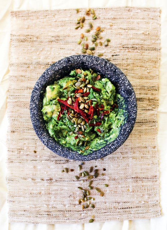 Roasted Poblano Guacamole  This guacamole is my secret weapon, a food ambassador for avocados everywhere. It has complexity and depth from the roasted poblano garlic paste, creaminess from the avocado, and brightness from the fresh lime. Whenever I serve this as part of a guacamole bar, it is always the first to go. - Jason  Makes 3 1/2 Cups Heat Level: 2   Ingredients: •	1 poblano chile, pan-roasted or fire-roasted  •	6 cloves garlic, pan roasted
