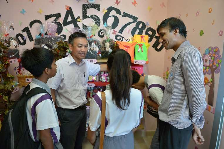 Principal of Northlight School with students