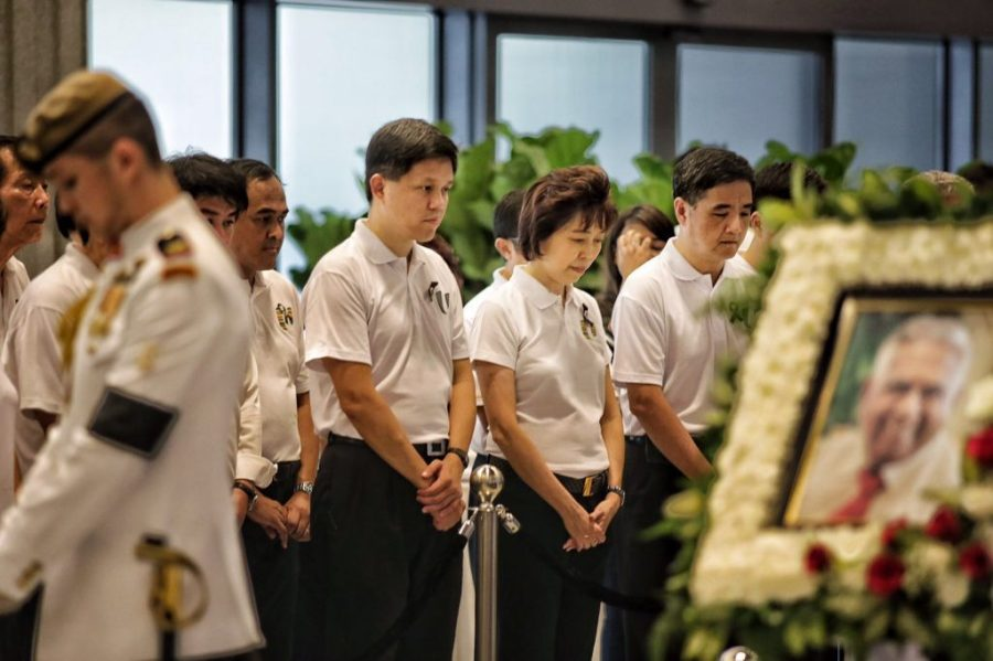 (L-R) NTUC Secretary General Chan Chun Sing, NTUC President Mary Liew and NTUC Deputy Secretary General Heng Chee How, together with union leaders, paying their last respects to Mr S R Nathan. (via NTUC)