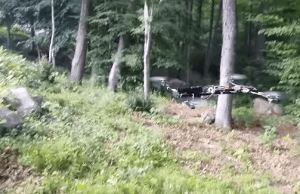 robot apocalypse: gun attached to flying drone