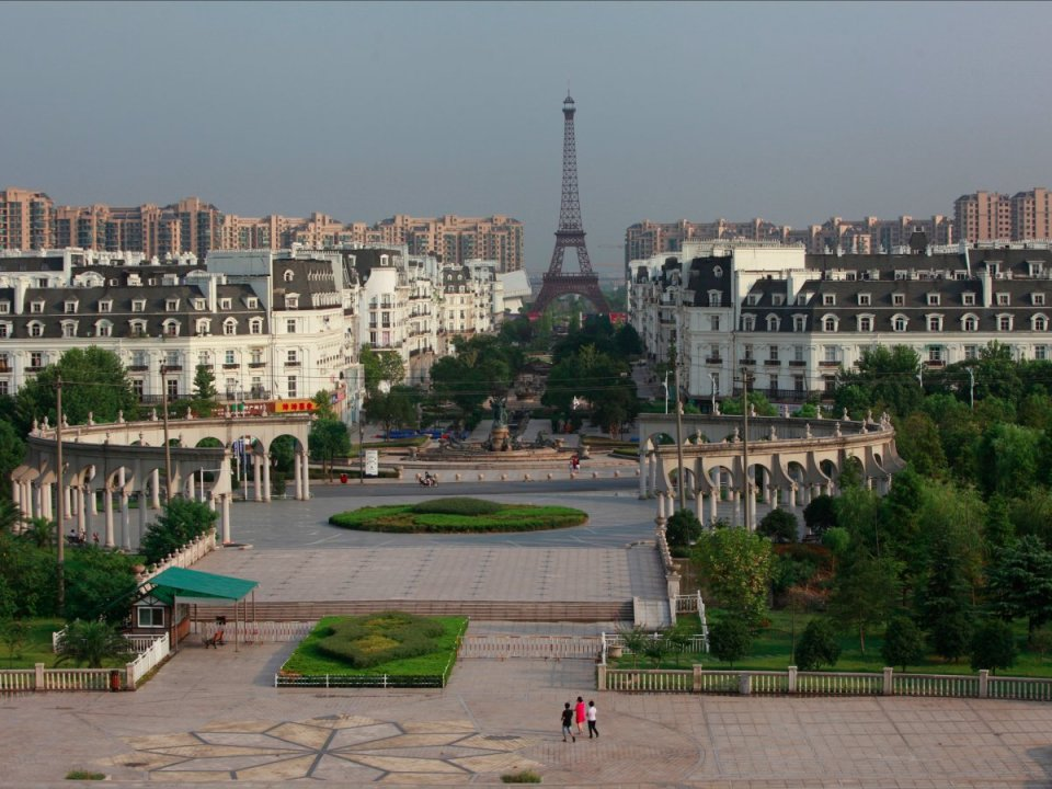 a-few-hours-outside-of-shanghai-youll-come-across-tianducheng-a-wannabeparisthat-features-a-354-foot-replica-of-the-eiffel-tower-however-despi