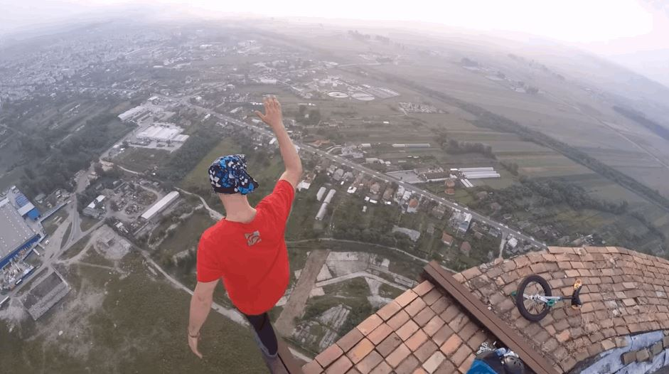 Today in extremely dangerous activities performed for the sake of YouTube popularity: a stunt performer rides a unicycle atop a 840-foot chimney.