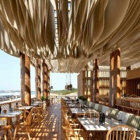 Something Magical Happens When the Wind Hits the Ceiling of this Beach Bar