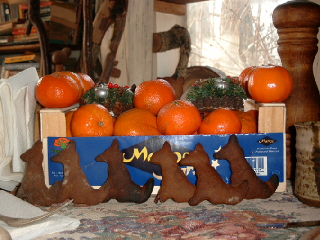 Gingerbread cookies and mandarine oranges as decoration for Christmas