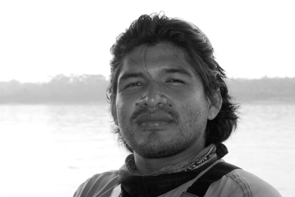 A gray-scale picture of lead guide Naun Amable Silva working in the field as