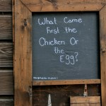 """""""What came first the chicken or the egg"""" sign in front of a stall in Ardenwood Historic Farm, Fremont"""