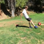 Kicking the ball at foot golf, Sunken Garden in Sunnyvale