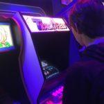 Playing arcade games at High Score, Alameda