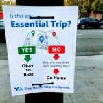 Sign at a busstop in Mountain View. Is this an Essential Trip? Yes -> Okay to Ride. No -> Why are you even here reading this?-> Go Home. Stay Home. Stop the Spread.