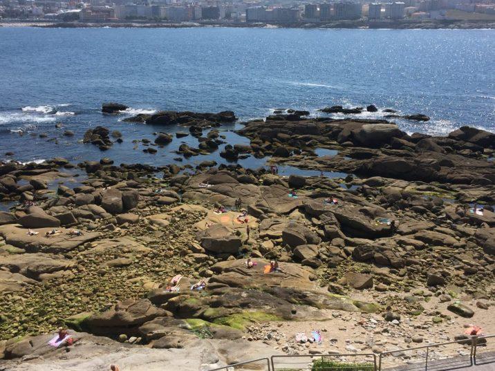 Sunbathers on the rocks