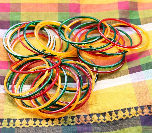 Our tablecloth sari and the colorful bangles we'll be wearing with it.