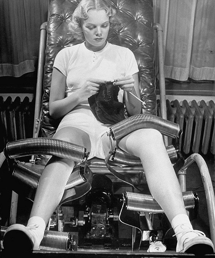 Legs massage with metal rollers for the weight loss. USA, 1940s.