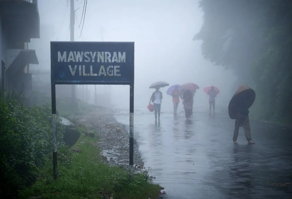 The entrance to Mawsynram Village. Like most villages in the Meghalaya region of India's northeast, the people here are Khasi, an indigenous minority numbering about 1.2 million within India. (© Amos Chapple)