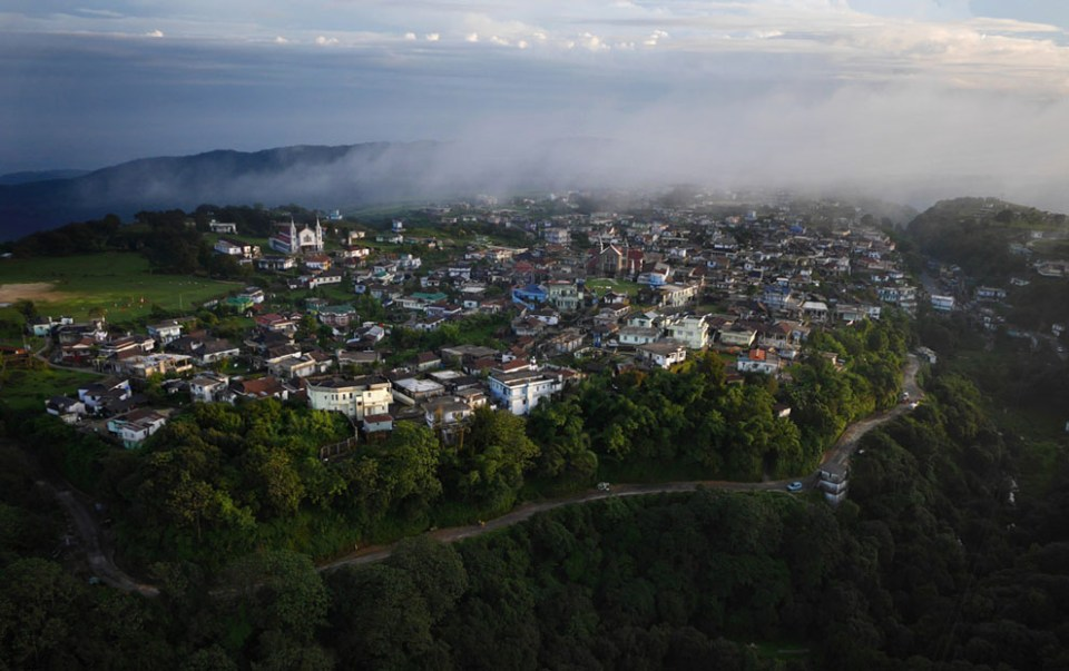 "The village of Mawsynram, claiming to have the highest average rainfall on Earth. Perched atop a ridge in the Khasi Hills of India's northeast, the village receives 467 inches of rain per year - thirteen times that of Seattle. The heavy rainfall is due to summer air currents sweeping over the steaming floodplains of Bangladesh, gathering moisture as they move north. When the resulting clouds hit the steep hills of Meghalaya they are ""squeezed"" through the narrowed gap in the atmosphere and compressed to the stage they can no longer hold their moisture, causing the near constant rain the village is famous for. (© Amos Chapple)"