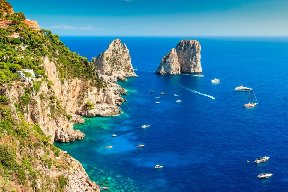 Faraglioni cliffs panorama,and the majestic Tyrrhenian sea,Capri island,Italy,Europe