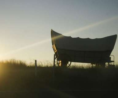 A backlit covered wagon