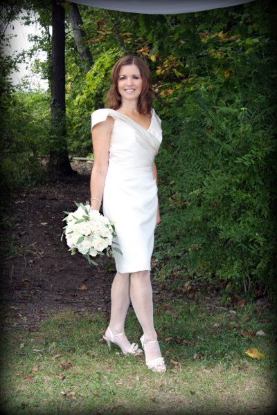 Mid-life bride in short dress