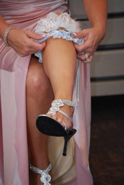 Tan legs, rhinestone shoes and blue garter