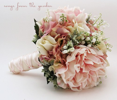 pink peonies with roses and lily of the valley