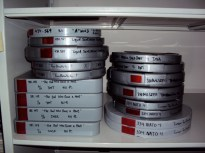 Archival film cans post-lab inspection.