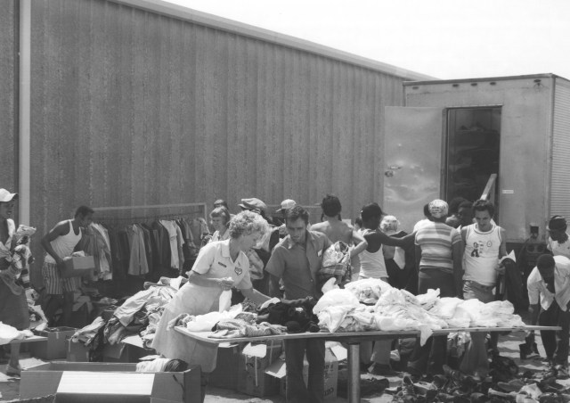 Donations of clothing came in through the Red Cross, Eglin Base Chapels, and local citizens. One of the first things many Cubans did upon arriving at the camp was to pick out a change of clothes, though sometimes it was hard to find the right size. Local ID: 342-CR-25