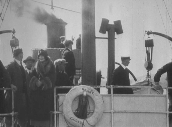 A scene on the deck of a ship. A smokestack