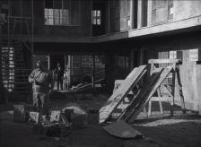 Polston navigates construction debris at the job site.
