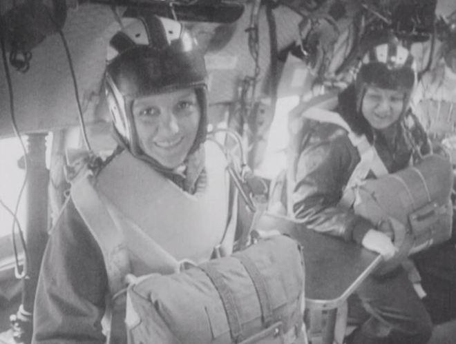 Women sailors prepare for a parachute jump at the end of their parachute rigger training.