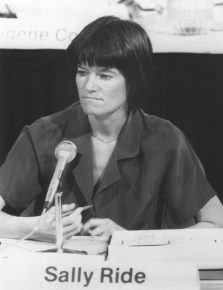 255-CB-86-H-272: Astronaut Dr. Sally K. Ride, a Member of the Presidential Commission on the Space Shuttle Challenger Accident, Listens to Testimony at an Open Hearing at the Kennedy Space Center.