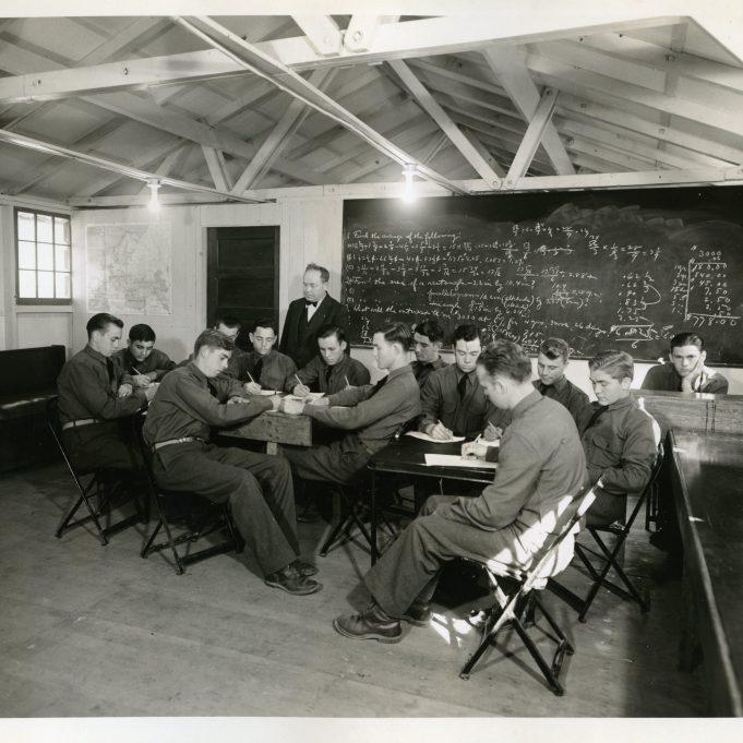 "35-GE-1G-1 ""Class III CCC enrollees studying project math. W. Camp SCS-4, Sebastopol, Calif. W. M. Billman, WPA Teacher."""
