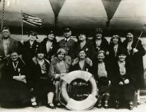 """Original Caption: """"A group of Pilgrims of Party """"S,"""" with Capt. Shannon, aboard the AMERICA on the voyage to Europe."""" Local ID: 92-GS-2-110."""
