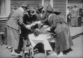 Women practice first aid.