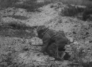 This image from Flashes of Action shows two snipers in camouflage rock suits.