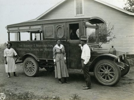 """""""Madison County, Alabama. African-American agents and rural nurse with movable school. [The Booker T. Washington Agricultural School on Wheels.]"""" 1923.(16-G-280-S-2544C)"""