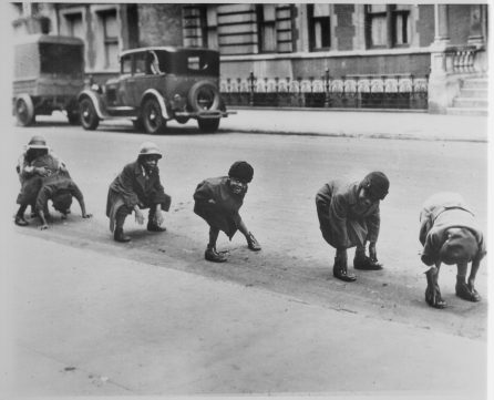 """""""Black children playing leap frog in a Harlem street."""" (Image ID: 306-NT-171.611C)"""