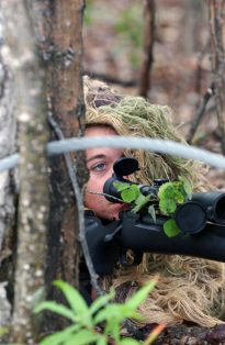 """""""US Air Force (USAF) AIRMAN First Class (A1C) Kristin Ferris, Sniper (one of only five enlisted female USAF snipers), 354th Security Forces Squadron (SFS), participates in an simulated emergency training scenario as she positions herself in the underbrush in preparation to eliminate a terrorist who has taken two hostages during a training exercise being conducted on Eielson Air Force Base (AFB), Alaska (AK)."""" Date Taken: August 2006 (Local ID: 330-CFD-DF-SD-07-03397)"""