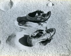 The end of the trail is suggested mutely by this pair of US military issue shoes found near five bodies in the Libyan desert. The shoes were among many items of US military equipment and personal effects undisturbed in 17 years. Local ID: 342-B-ND-075-4-A92671AC