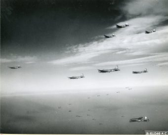 """342-FH-3A-19630 """"Boeing B-17 """"Flying Fortress"""" of the 91st Bomb Group, 8th Air Force, wing their way over enemy territory enroute to target in Brunswick, Germany. 30 January 1944"""""""