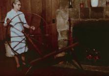 Spinning the wool (Still from Homespun)