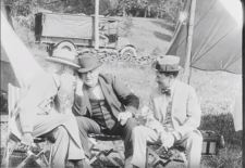 John Burroughs leans in to speak to Thomas Edison while Harvey Firestone looks on. (Still from FC-FC-4803)