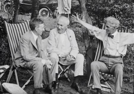 Henry Ford gesticulates while telling a joke to Harvey Firestone and Thomas Edison. (Still from FC-FC-4803)