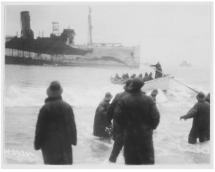 Original Caption: Transport Northern Pacific on Fire Island sand bar. Surf boat off to take troops off transport. Local Identifier: 111-SC-34304.