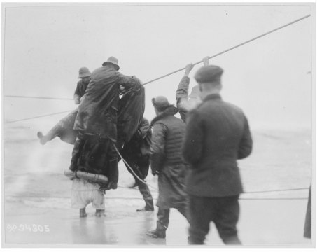 Original Caption: Transport Northern Pacific on Fire Island sand bar. A soldier arriving from the transport via the breeches buoy. Local Identifier: 111-SC-34305.