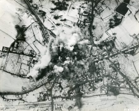 """Photo ID: 342-FH-3A-5165-55673AC. Original caption: """"More than 100 9th Air Force Martin B-26 Marauders, Christmas afternoon, dropped their bomb loads on the heart of St. Vith, Belgium, the important road junction and communications center captured by the Germans in their counter-offensive. Marauders, Havocs and Invaders bombed bridges, roads, towns, and strong-points. Christmas day in a part of a systematic plan to isolate German troops from their supply sources."""" Date: December 25th, 1944"""