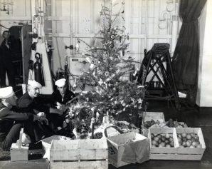 "Photo ID: 80-G-372570. Original caption: ""Christmas tree aboard the USS Takanis Bay (CVE089)."" Date: December 25th, 1944"