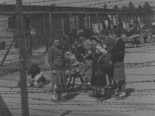 Women behind barbed wire at Mauthausen.